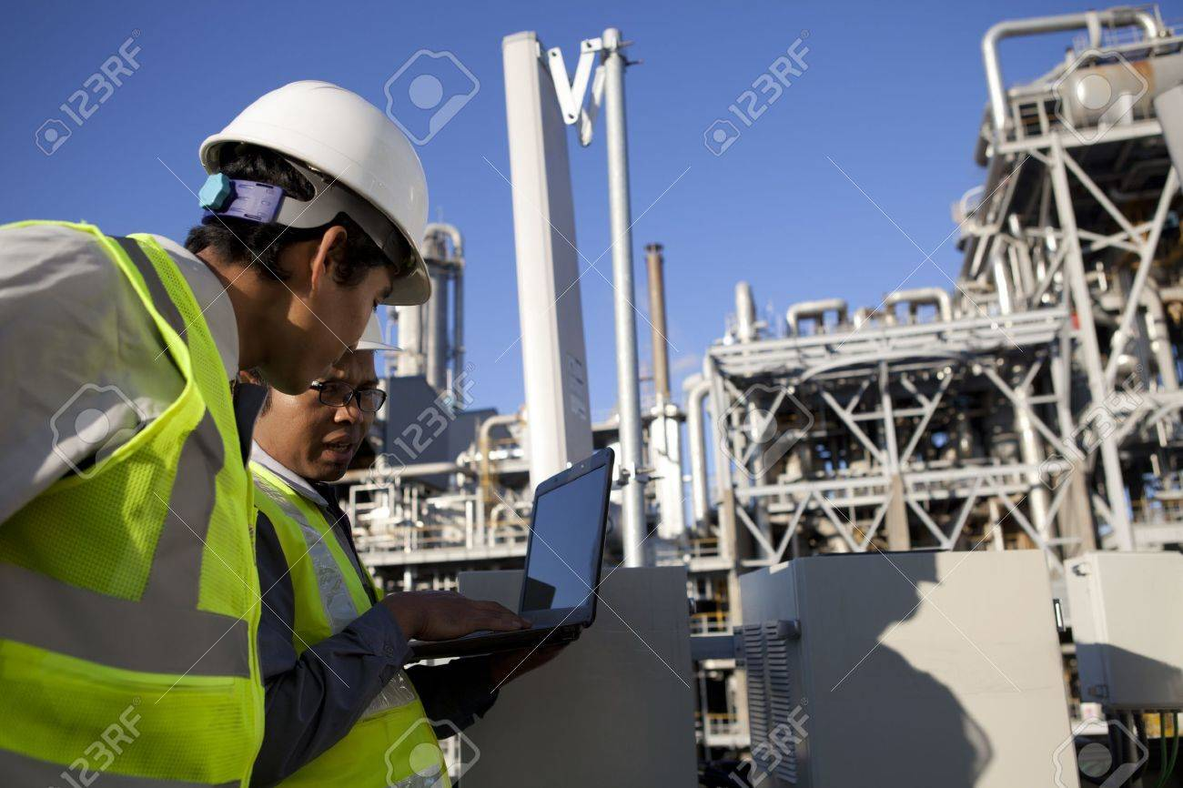 two engineer power and energy discussion on location site Stock Photo - 16521165