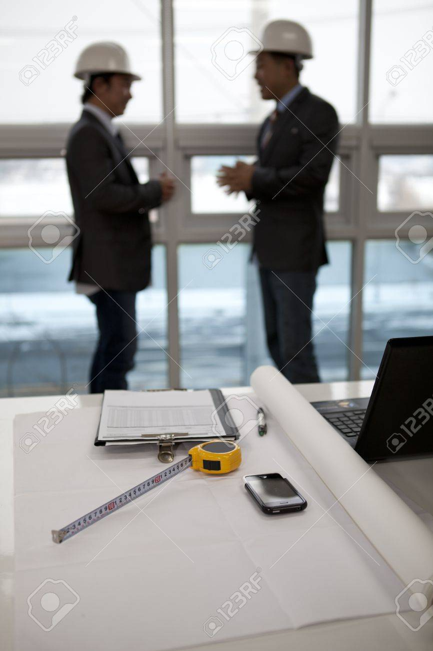 architects sitting at table and discussing a project in the office Stock Photo - 17232088