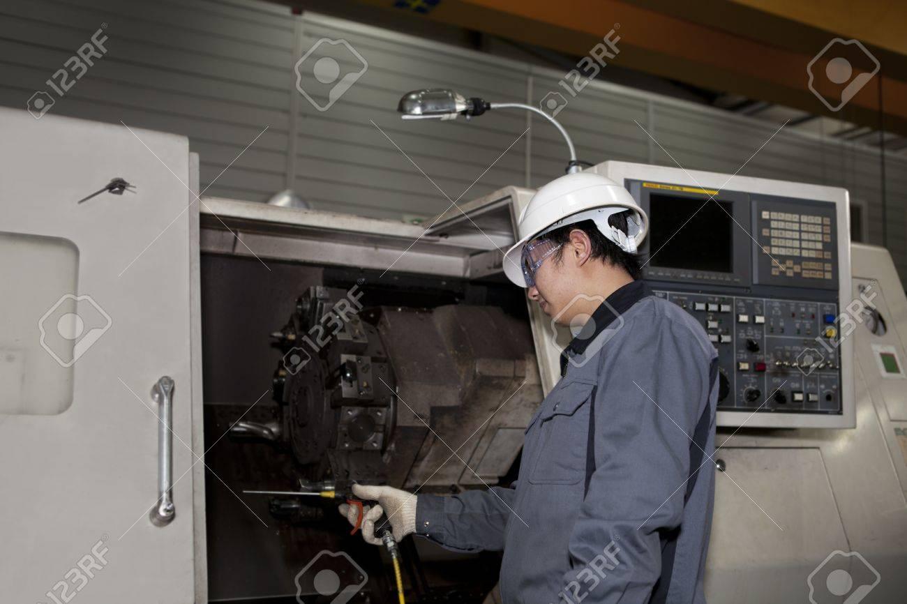 mechanical technician operative of cnc machine Stock Photo - 17365725