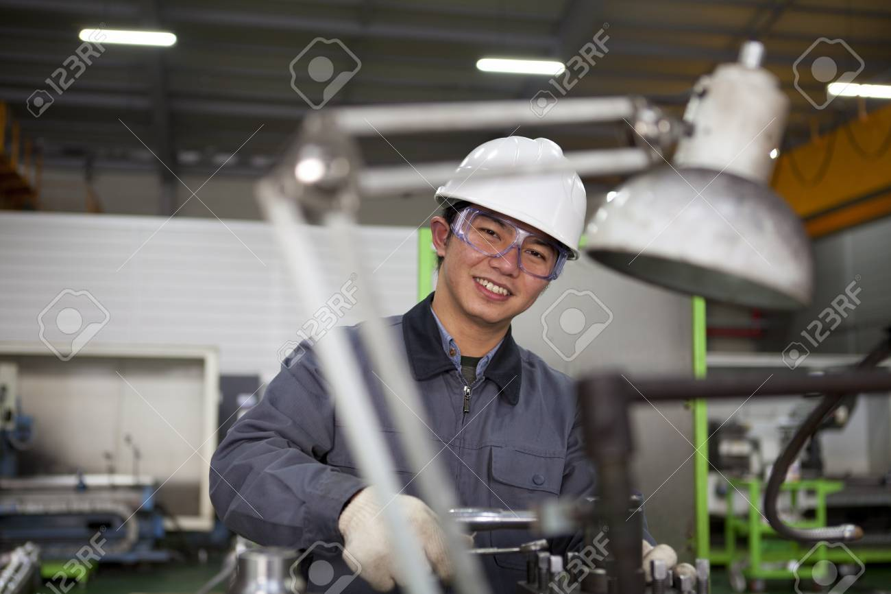 modern industrial machine operator working in factory Stock Photo - 17345819