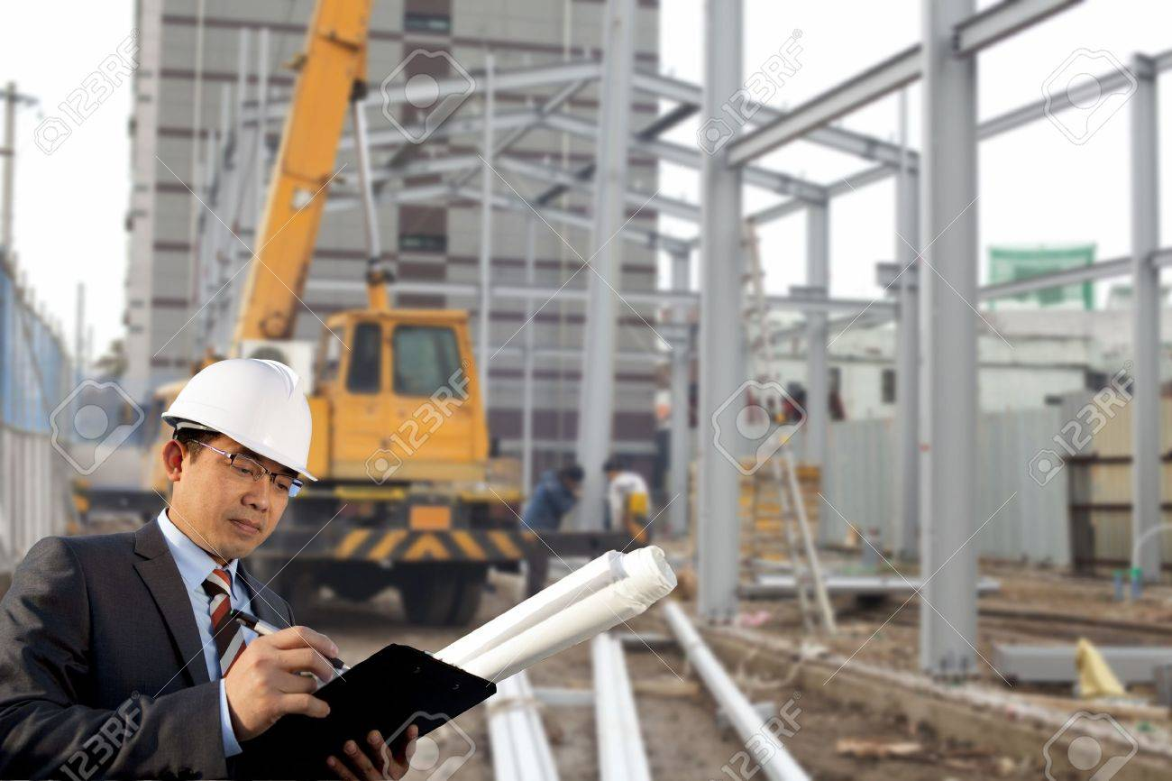 young architect standing front of construction site Stock Photo - 17345870