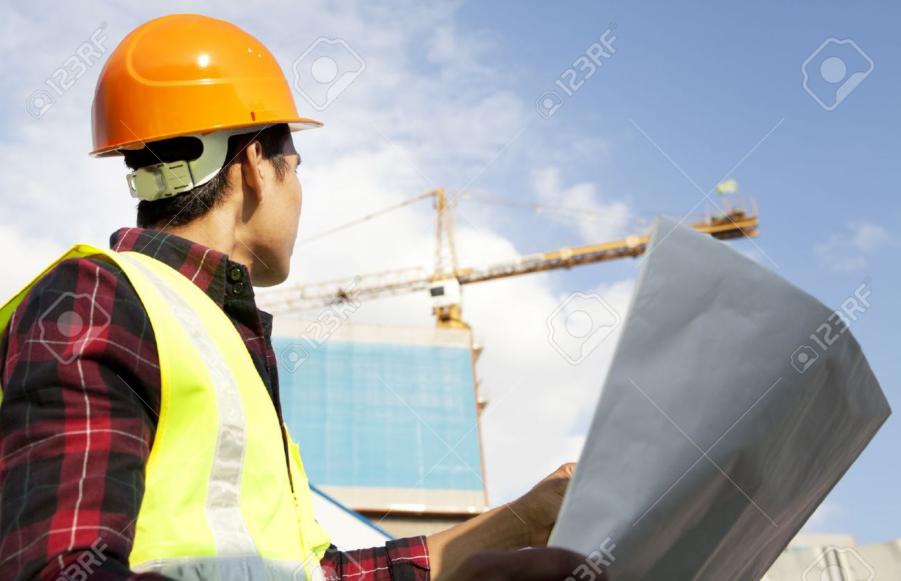 Engineer builder with blueprint at construction site stock photo engineer builder with blueprint at construction site stock photo 21963018 malvernweather Image collections