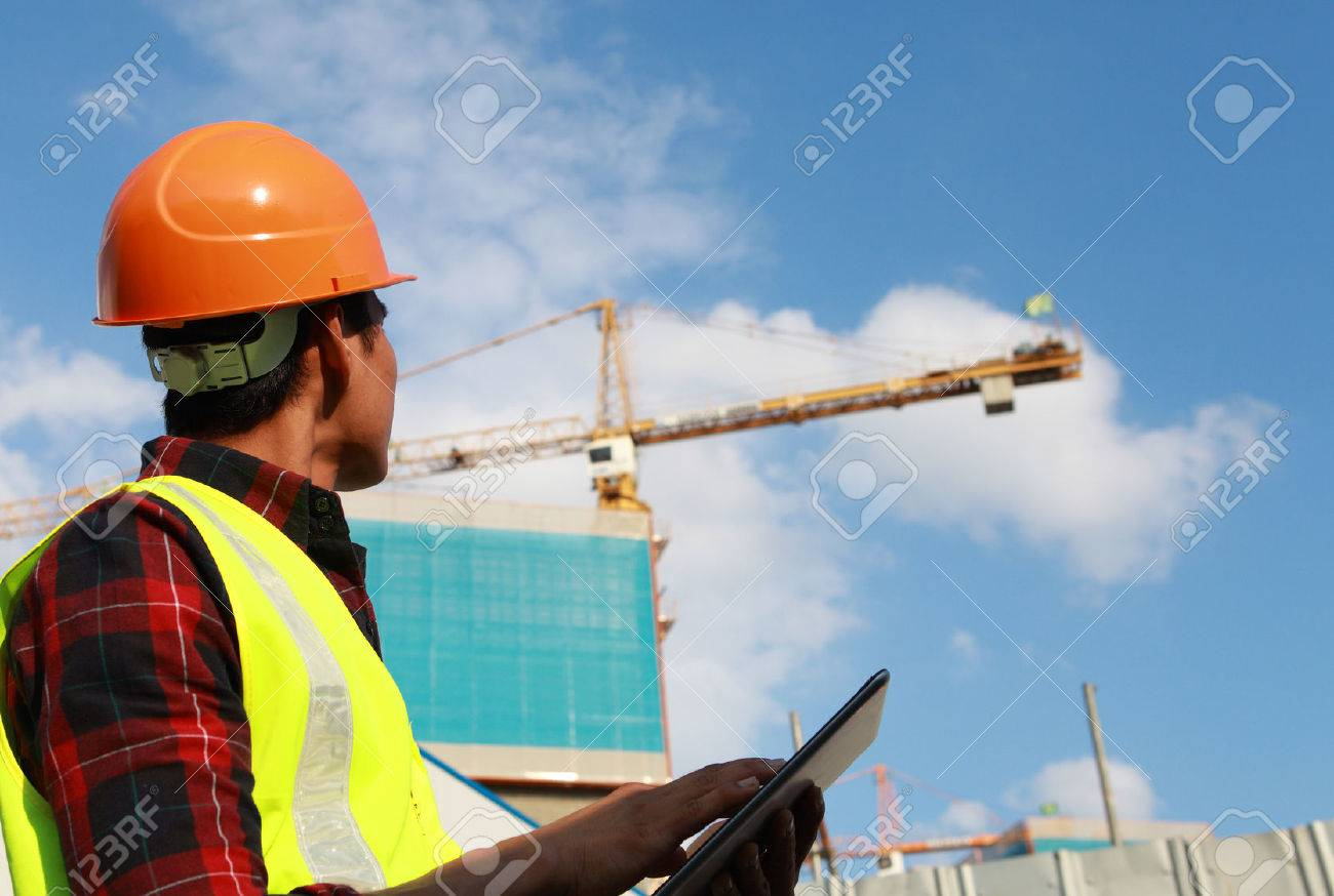 builder worker activity with digital tablet on construction site - 23461548
