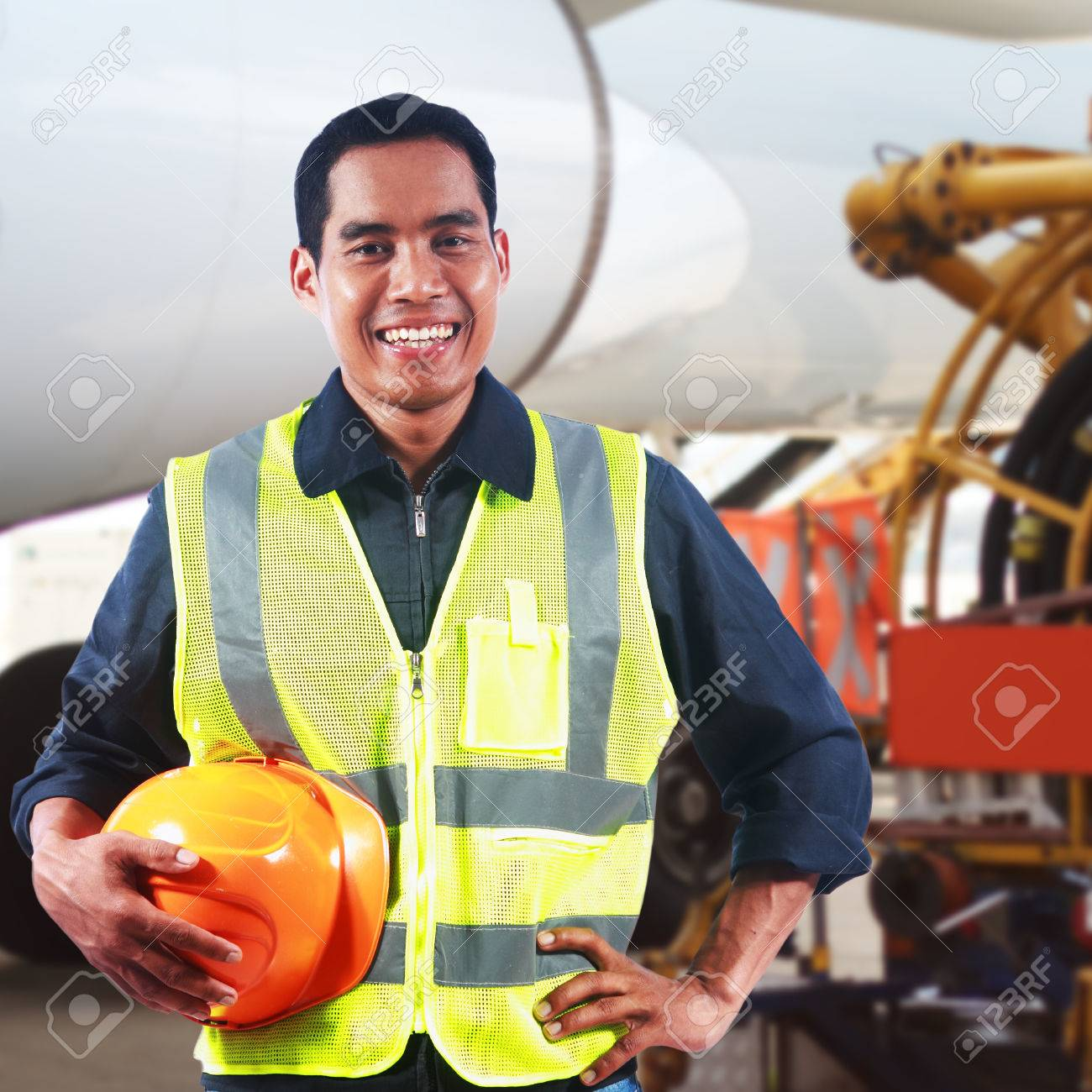 Portrait of asian professional engineer holding safety helmet at work Stock Photo - 27581344