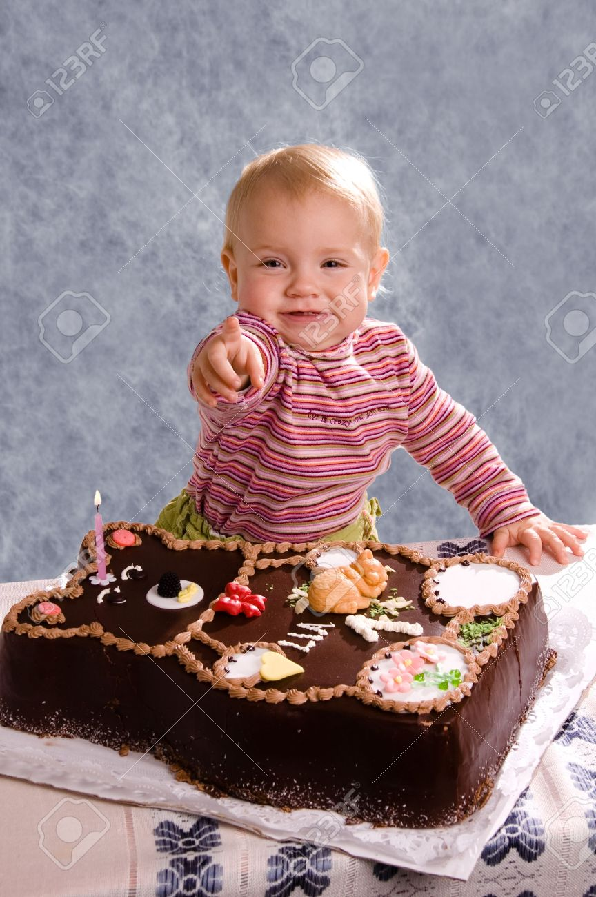 Cute Baby With A Birthday Cake Stock Photo