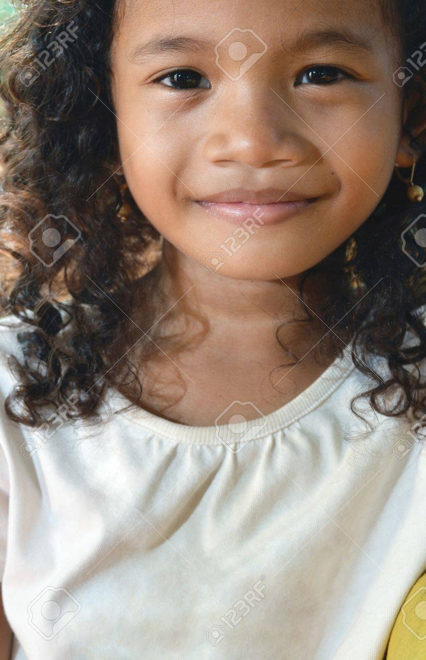 Asian girl with curly hair