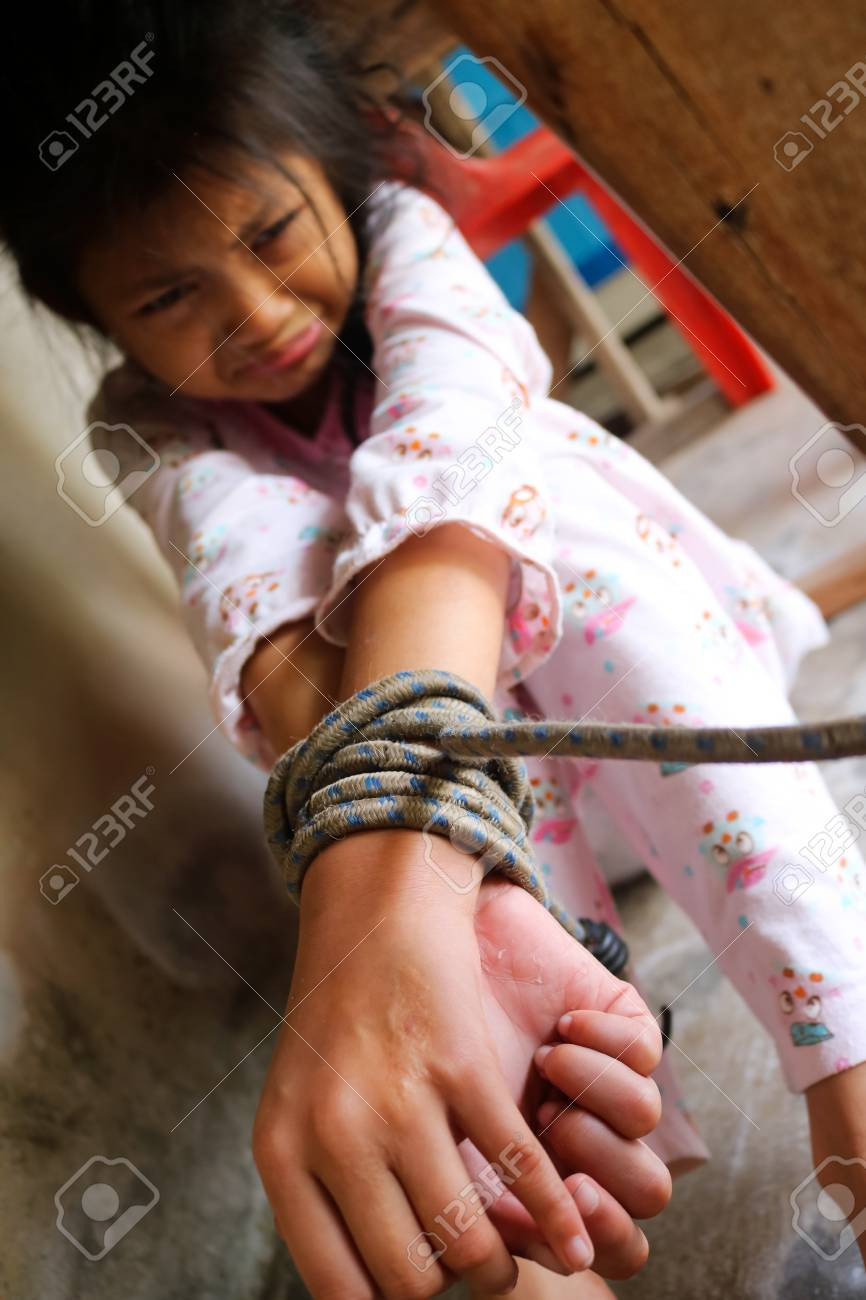 Asian human trafficking concept.Rope tied the hands of Thai girls. Stock  Photo -