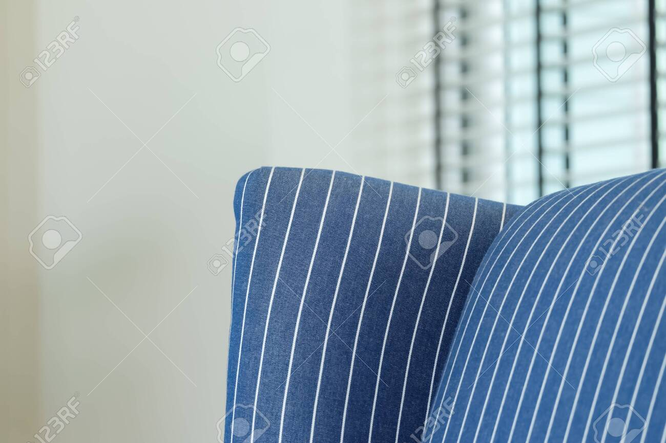 Close up detail of blue Striped sofa in a living room.