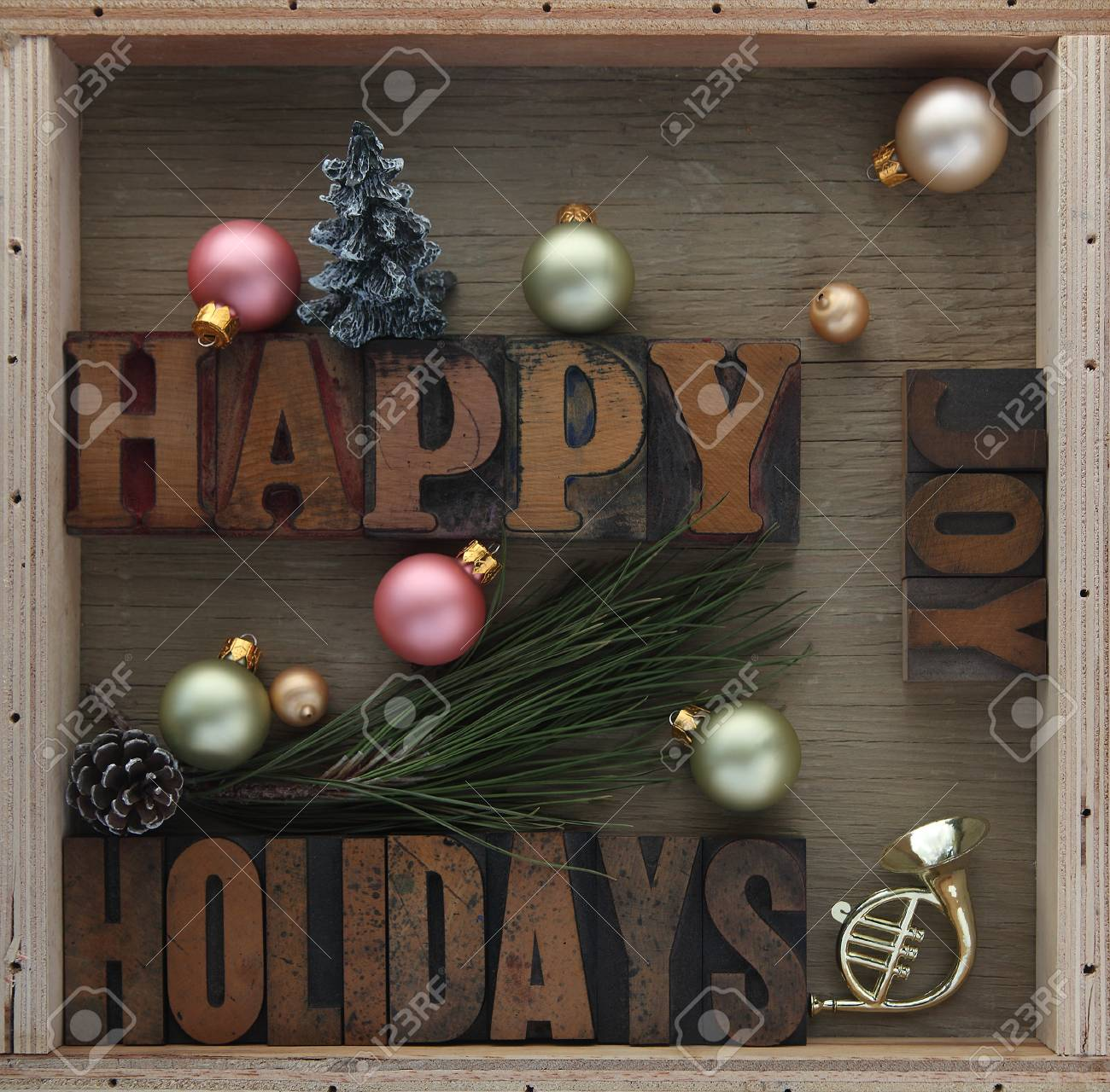 happy holidays words with ornaments pine cone toy horn and stock