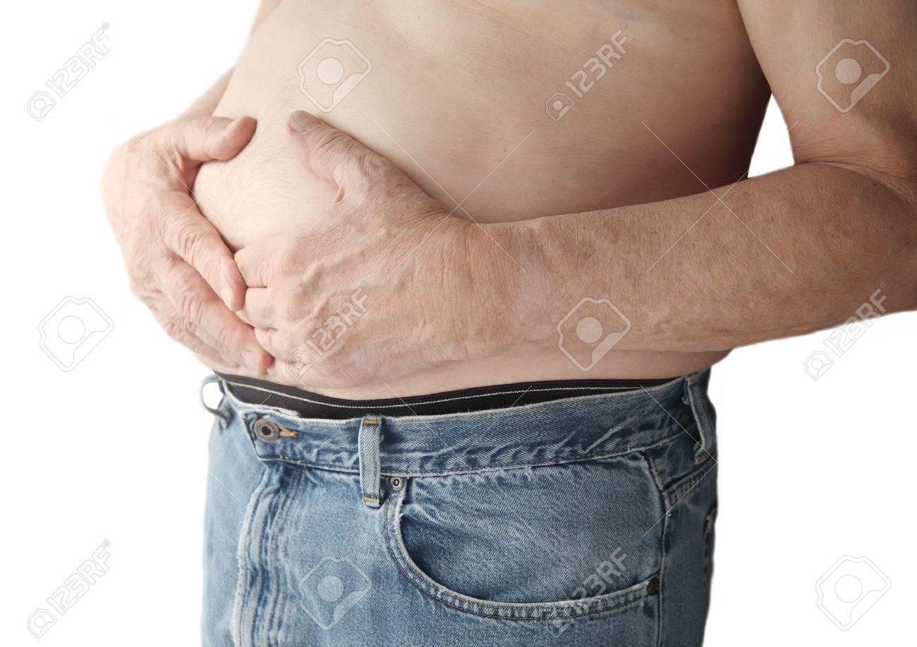 Un Hombre Llega A La Zona Del Estómago Con Ambas Manos Fotos ...