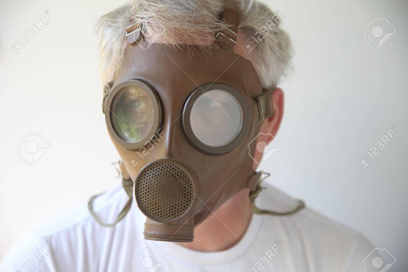 older man wearing an old gas mask