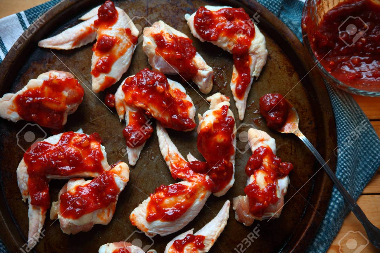 Overhead view of chicken wings ready to bake - 118384924