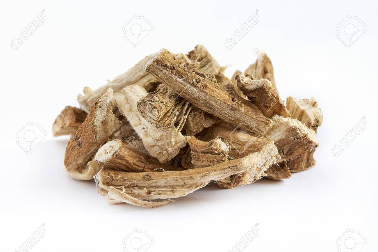 Pile of dried and sliced marshmallow root (Althaea officinalis) isolated on white background - 75229513
