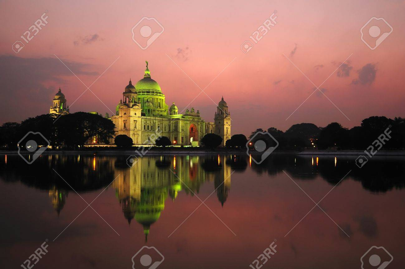 Majestic Victoria Memorial building reflected across lake at sunset Stock Photo - 10101427