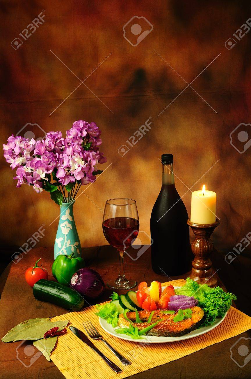 Still life of delicious dish of fish with salad and served with vintage red wine vertical image Stock Photo - 10615816