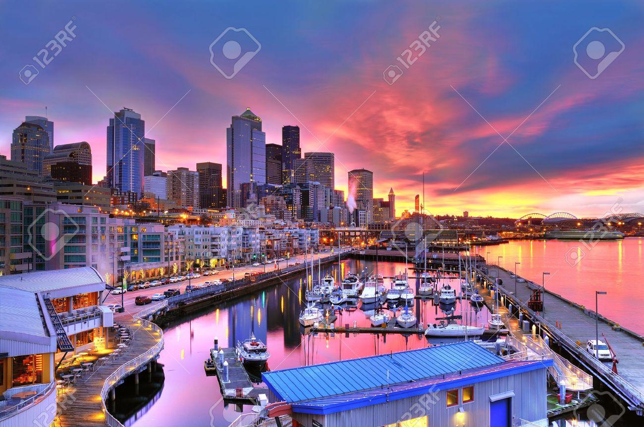 Famous Seattle skyline dazzling under a beautiful dawn sky across pier-66 waterfront - 10613576