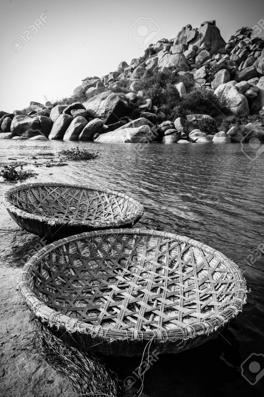 Stock photo traditional rural coracle boats on tungabhadra river in hampi in black and white