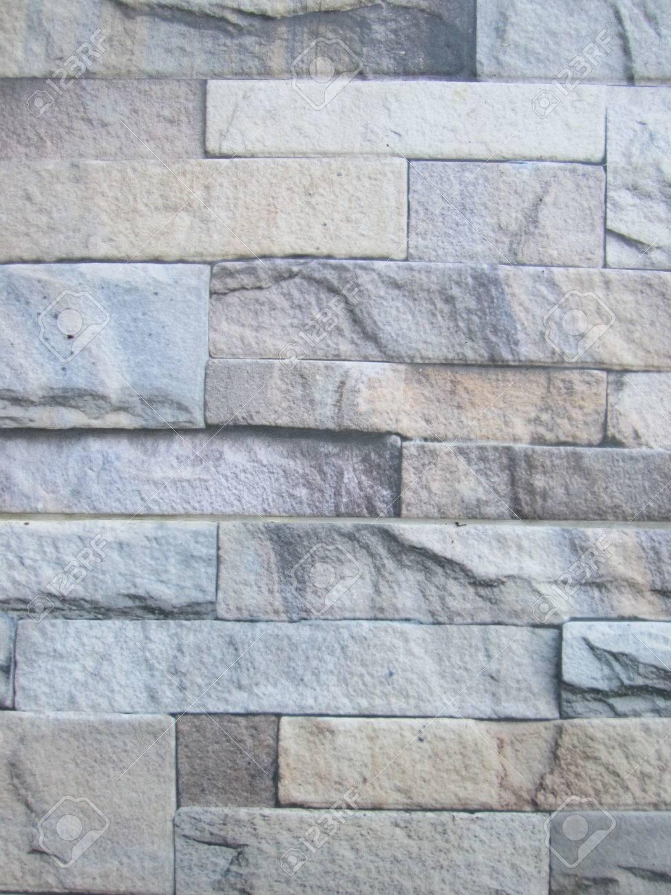 Muro Fatto In Pietra muro fatto di mattoni di arenaria come concatenazione. la pietra è stata  tagliata a pezzi con colore differente, muro diversa taglia, è molto bello.