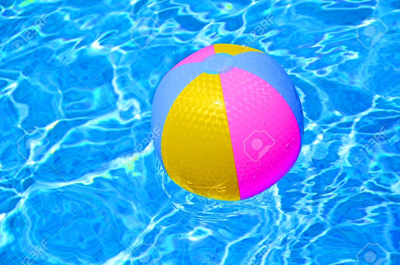 Pool Water With Beach Ball multicolored beach ball in swimming pool stock photo, picture and