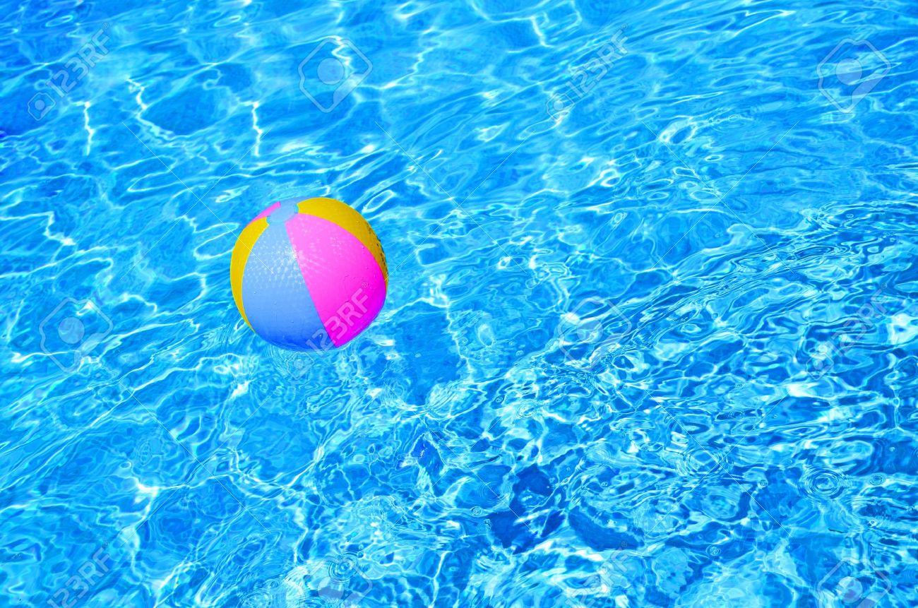 swimming pool beach ball background. Multicolored Beach Ball In Swimming Pool Stock Photo - 10257161 Beach Background L