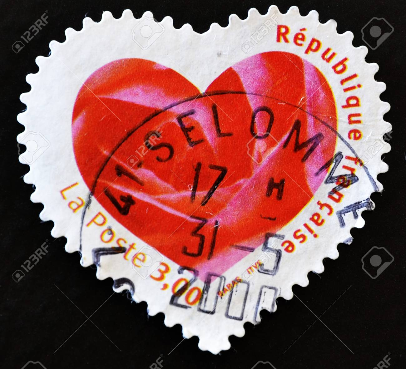 FRANCE - CIRCA 2003: A stamp printed in France showing a seal with the petals of a pink heart-shaped, circa 2003 Stock Photo - 10659019