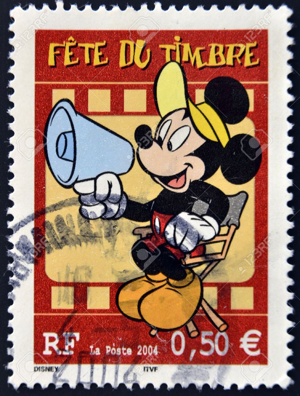 FRANCE - CIRCA 2004: A stamp printed in France shows Mickey Mouse as a film director, circa 2004  Stock Photo - 11071589