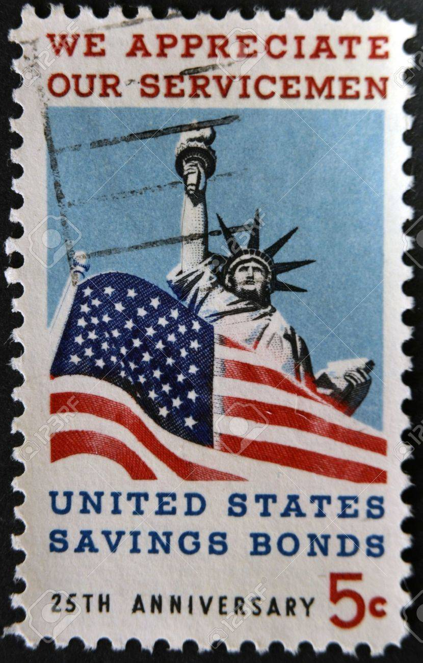 UNITED STATES OF AMERICA - CIRCA 1966: A stamp printed in USA dedicated to Honoring American servicemen and US savings bonds, shows Statue of Liberty and American Flag, circa 1966 Stock Photo - 12039702
