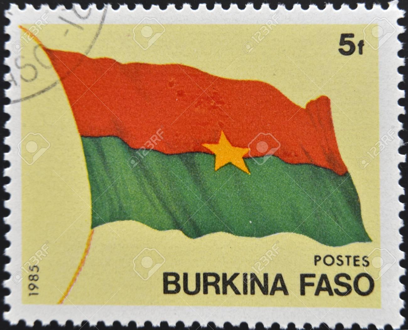 BURKINA FASO - CIRCA 1985  A stamp printed in Burkina Faso shows the flag, circa 1985 Stock Photo - 12570911