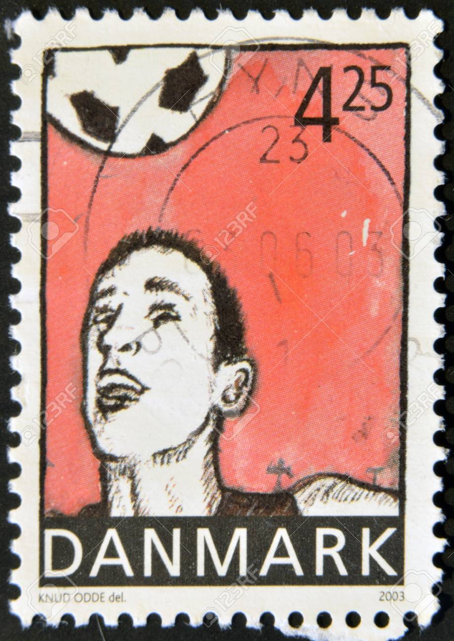 DENMARK - CIRCA 2003: A stamp printed in Denmark shows football player hitting the ball with the head, circa 2003 Stock Photo - 12570893