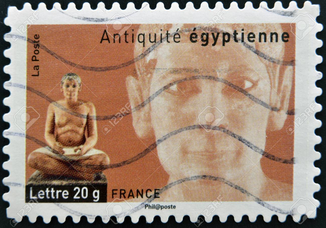 FRANCE - CIRCA  2007: A stamp printed in France dedicated to ancient Egypt, shows sculpture of a seated scribe, circa 2007 Stock Photo - 13749376