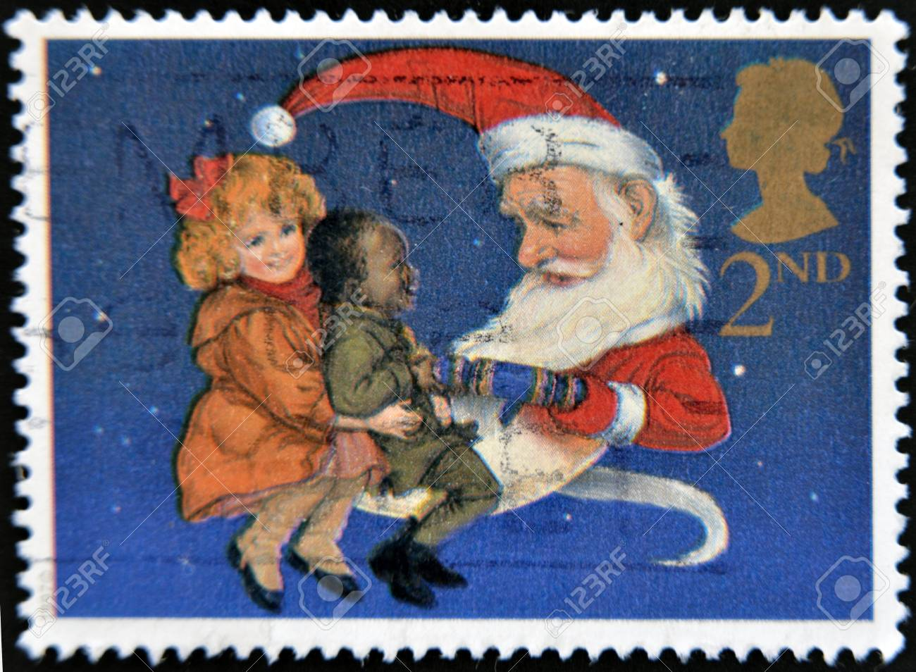 UNITED KINGDOM - CIRCA 1997: A stamp printed in Great Britain showing Children and Father Christmas pulling a Christmas Cracker, circa 1997  Stock Photo - 14137242