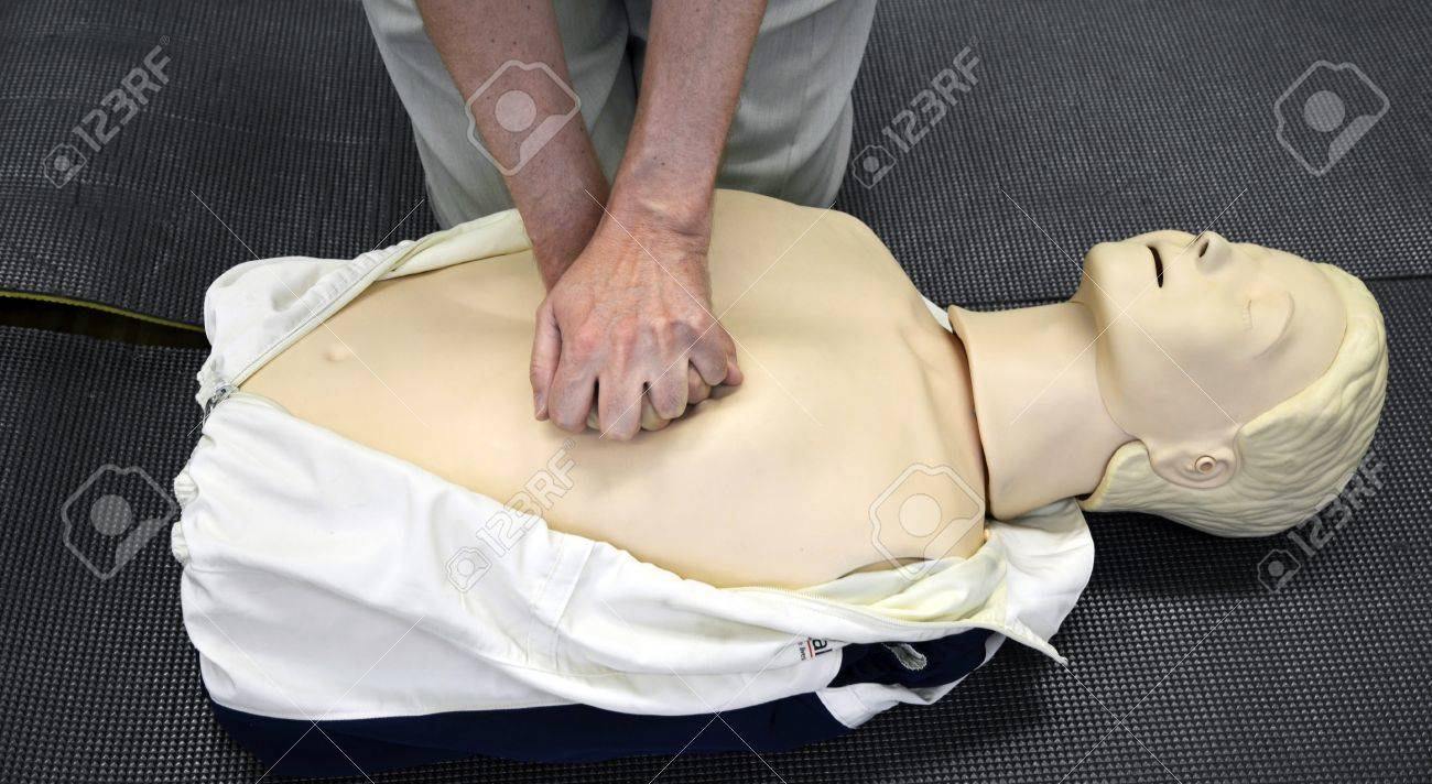 Man practicing CPR techniques on dummy. Stock Photo - 14081949