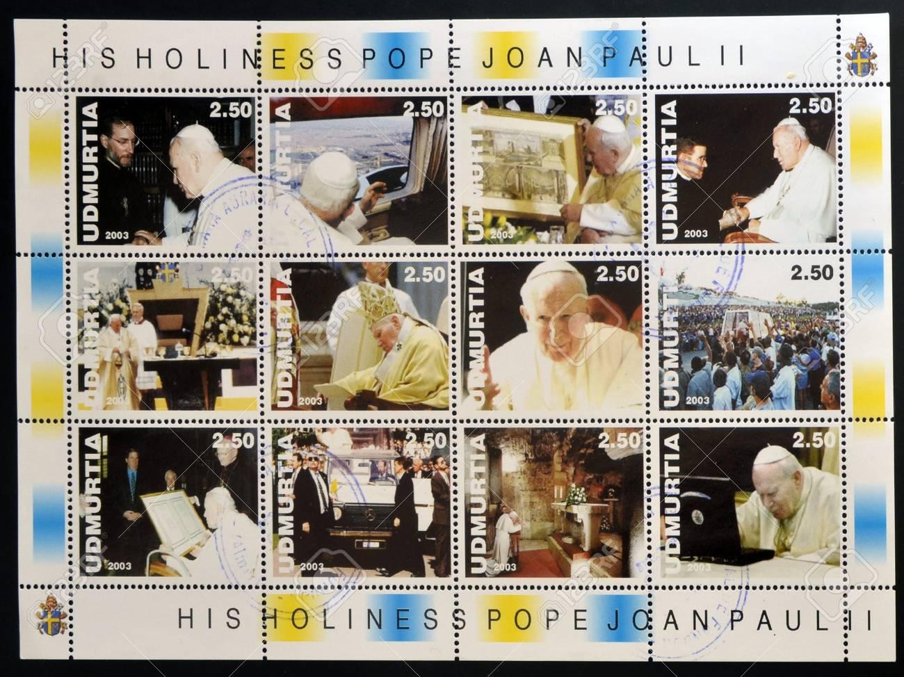 UDMURTIA - CIRCA 2003: Collection stamps printed in Udmurtia shows Pope John Paul II, circa 2003 Stock Photo - 14521098