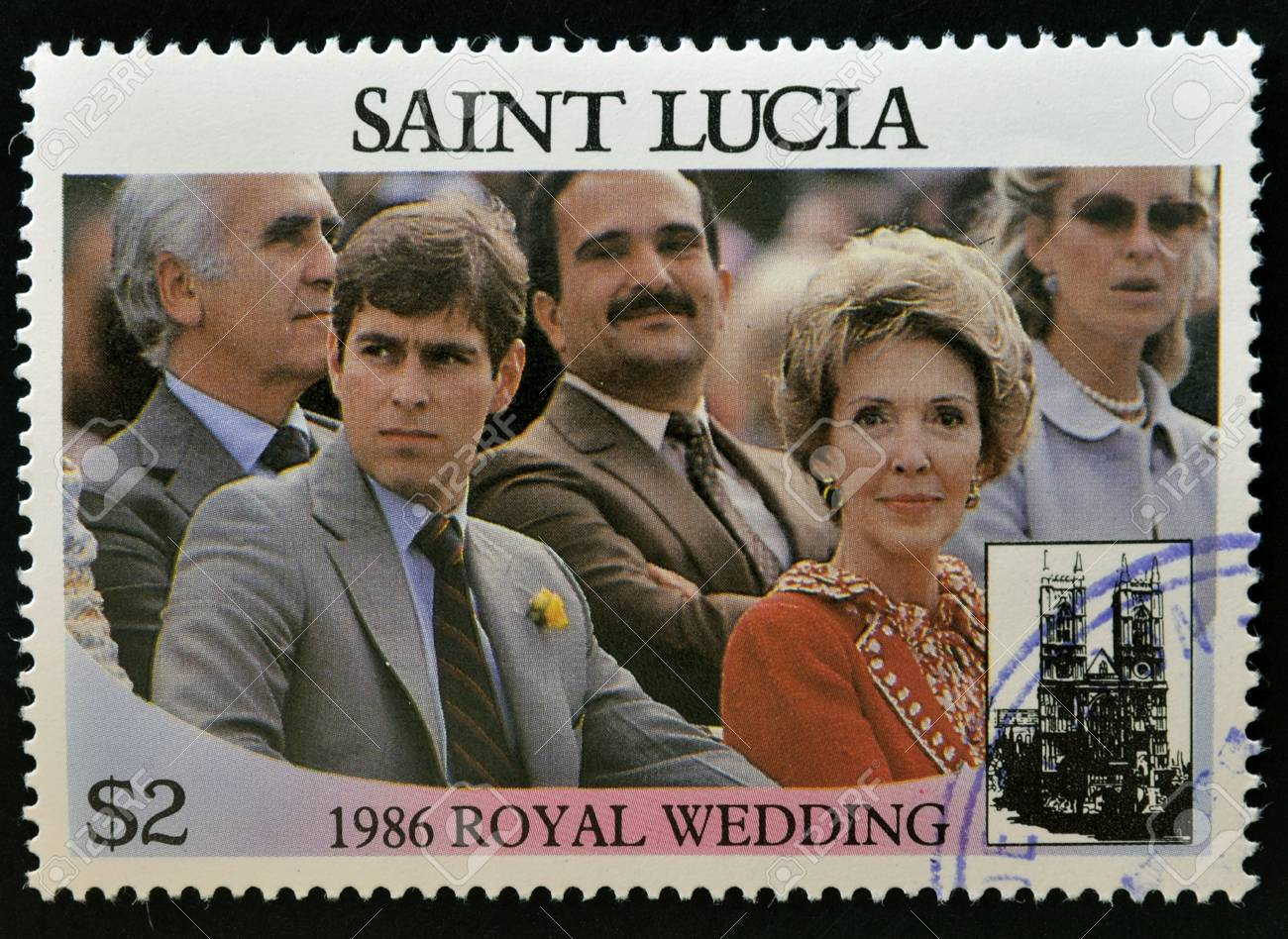 SAINT LUCIA - CIRCA 1986: A stamp printed in Saint Lucia shows a portrait of Prince Andrew of England and Nancy Reagan watching a parade, the royal wedding commemorative, circa 1986 Stock Photo - 14596874