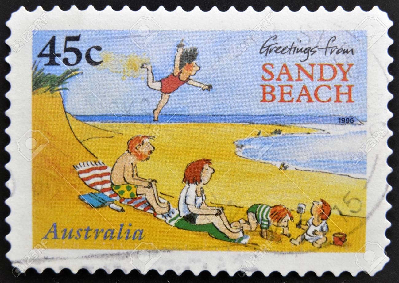 AUSTRALIA - CIRCA 1996: A stamp printed in australia shows greetings from sandy beach, circa 1996 Stock Photo - 15370501