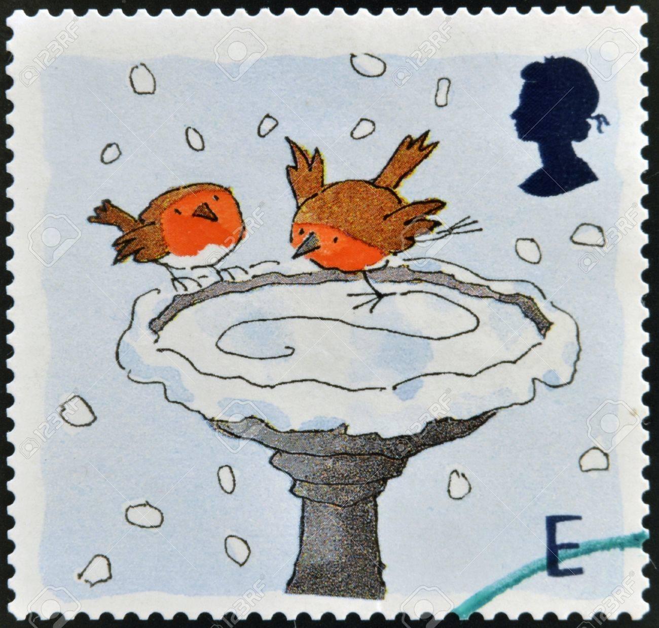 UNITED KINGDOM - CIRCA 2001: A stamp printed in England, is dedicated to Christmas, shows Robins skating on Bird Bath, circa 2001 Stock Photo - 16306859