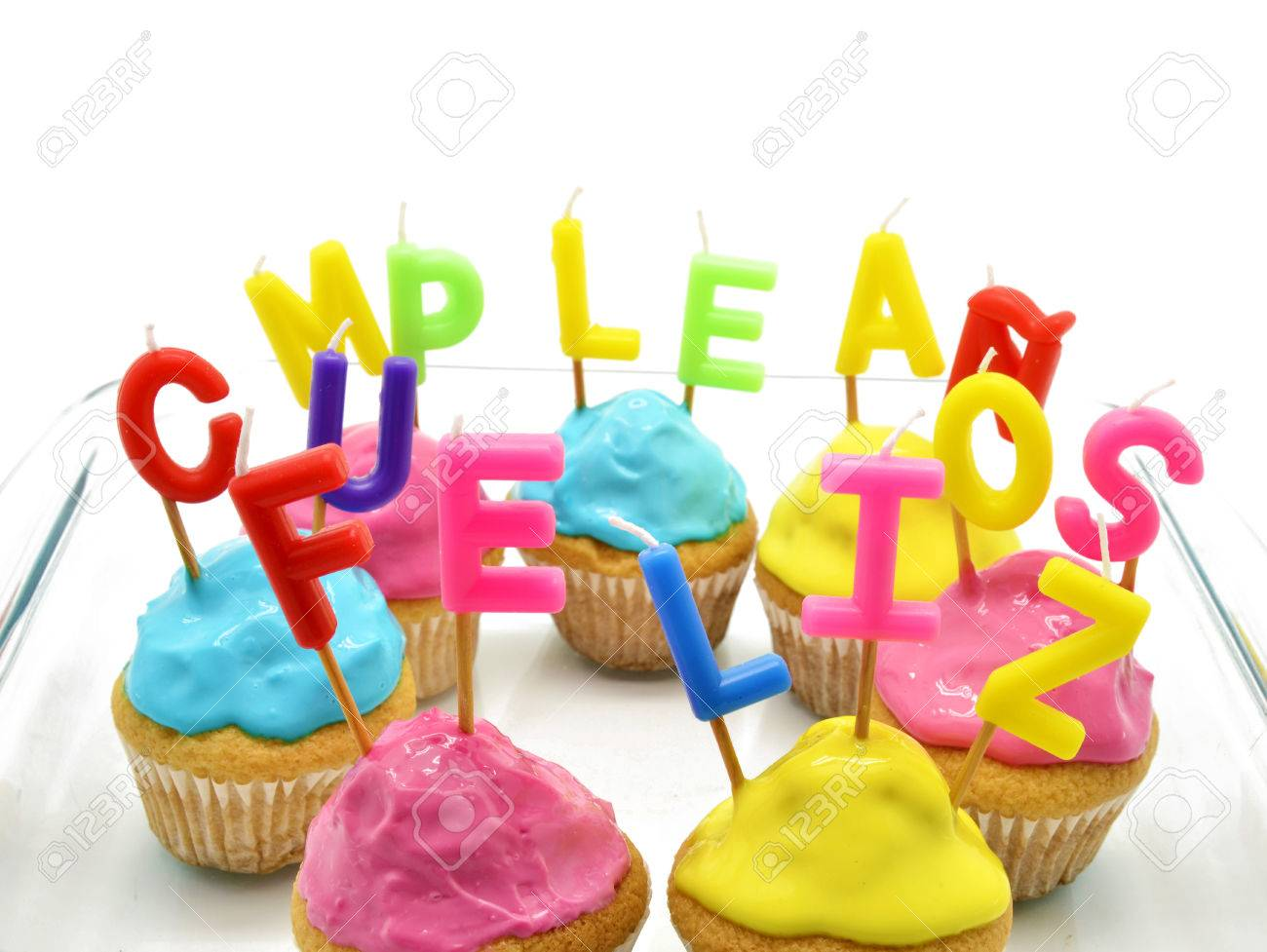 Birthday Cupcakes With Candles Happy Birthday In Spanish Stock Photo