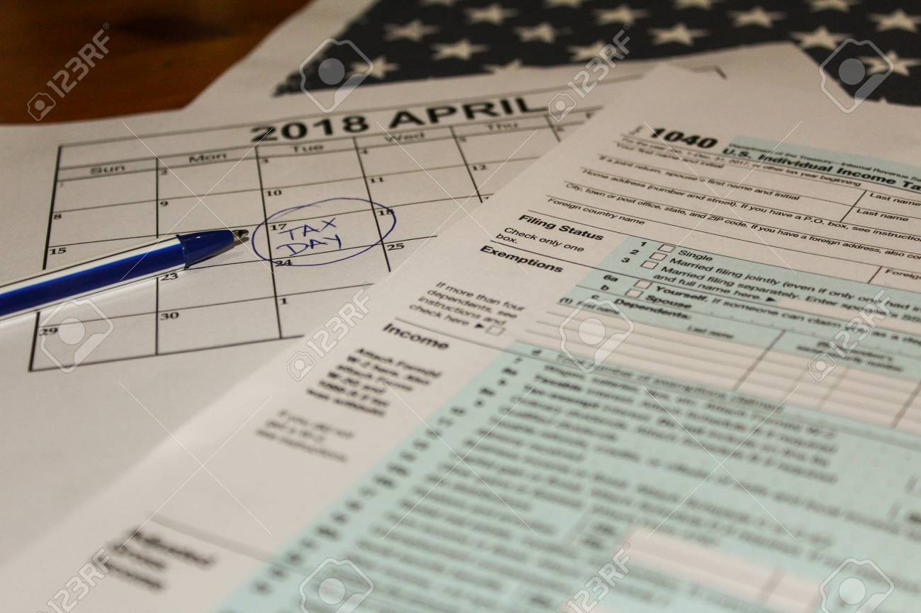 Calendar And Form 1040 Income Tax Form For 2017 Showing Tax Day