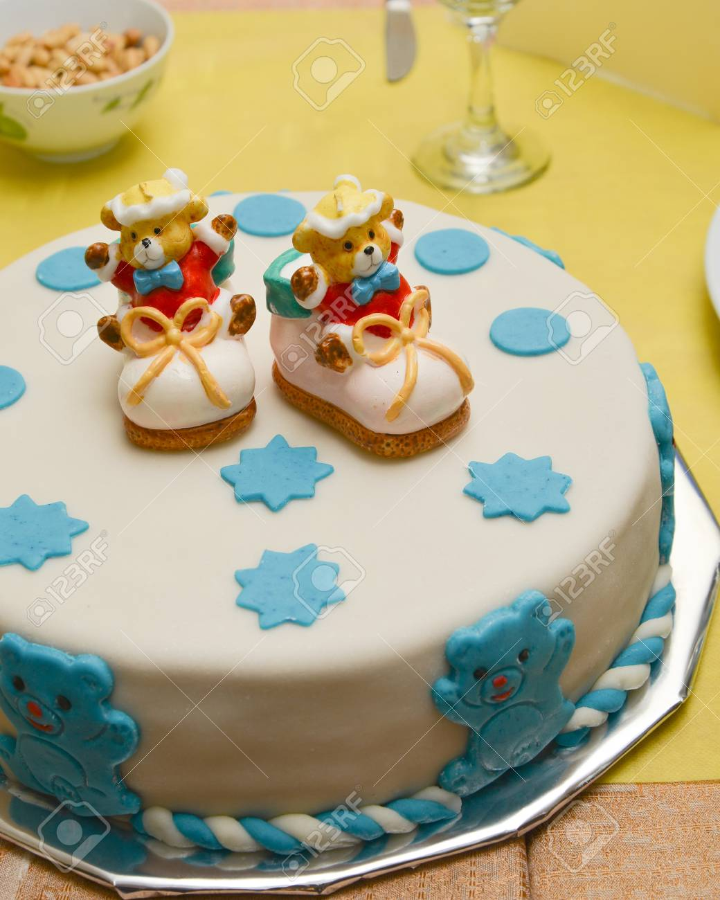 Baby Boy Birthday Cake With Cute Shoes Stock Photo