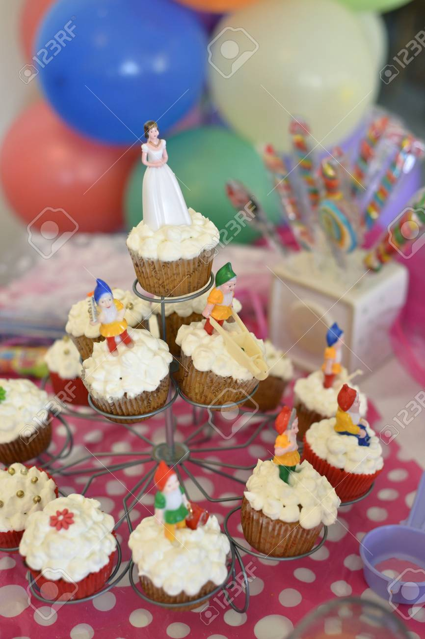 Colorful Birthday Cupcakes With Small Figurines Stock Photo