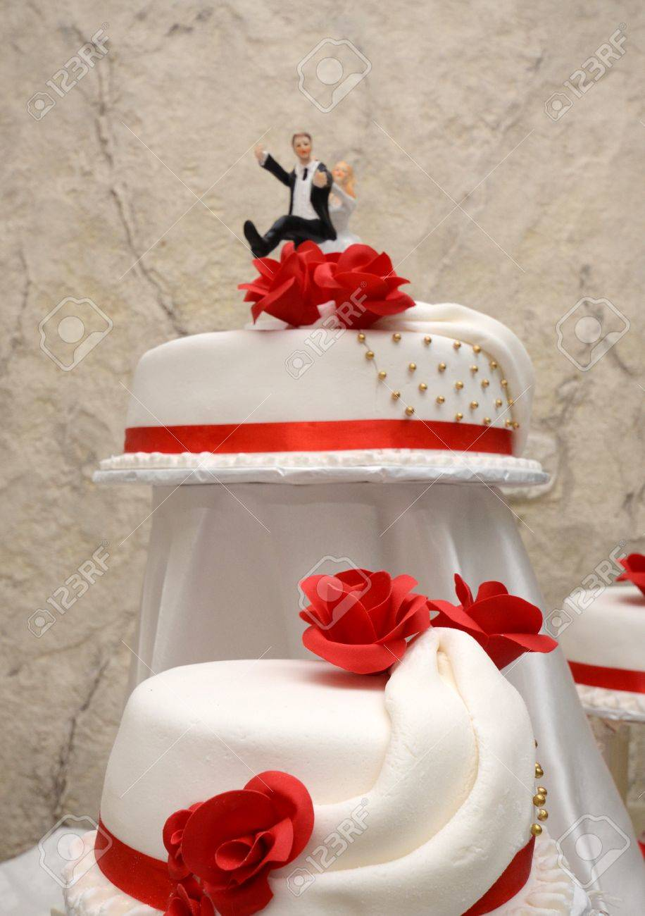 Picture Of A White Wedding Cake With Red Roses Stock Photo