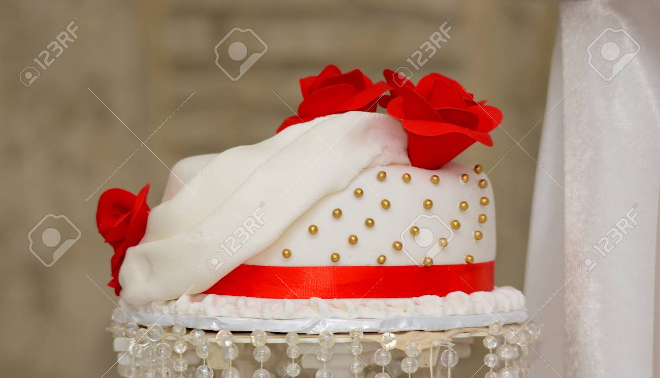 Picture of a white wedding cake with red roses stock photo picture picture of a white wedding cake with red roses stock photo 42676563 junglespirit Gallery