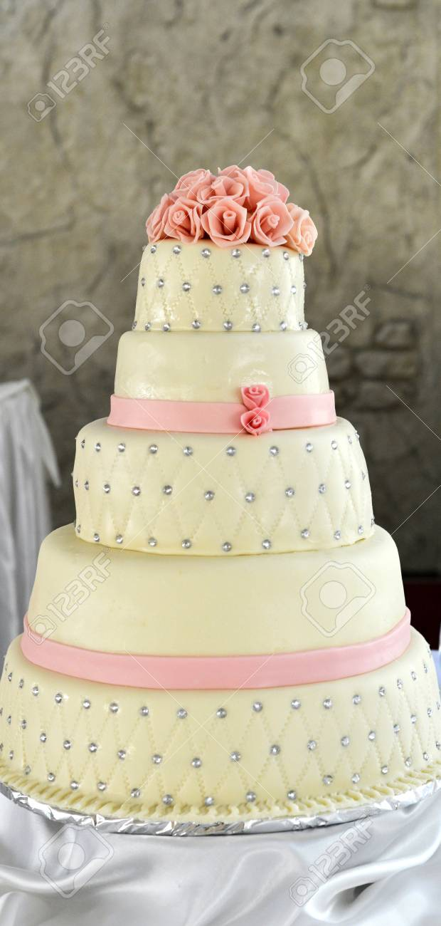 Picture of a white wedding cake and pink flowers on top stock photo picture of a white wedding cake and pink flowers on top stock photo 59922339 mightylinksfo