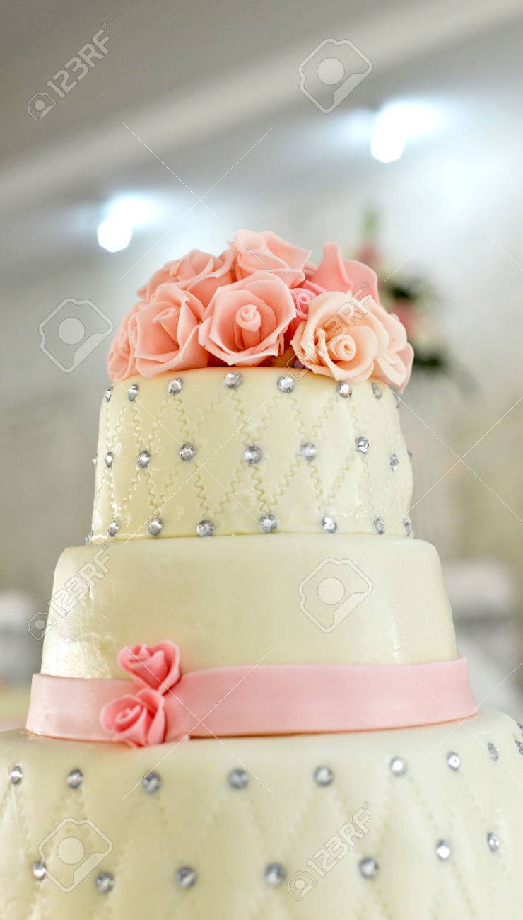 Picture of a white wedding cake and pink flowers on top stock photo picture of a white wedding cake and pink flowers on top stock photo 59922340 mightylinksfo Image collections