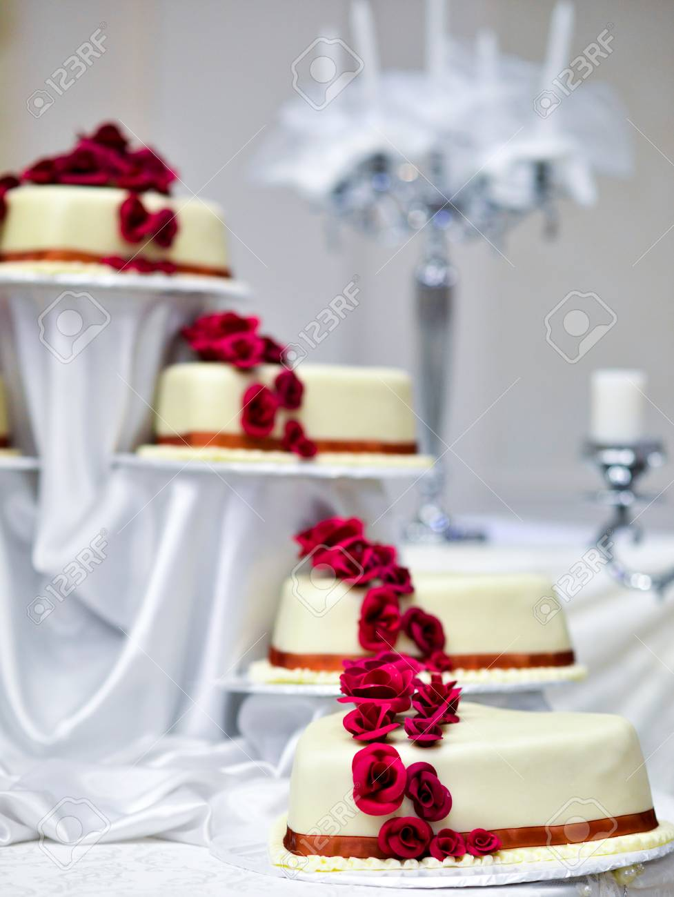 Picture Of A White Wedding Cake With Red Roses Stock Photo, Picture ...