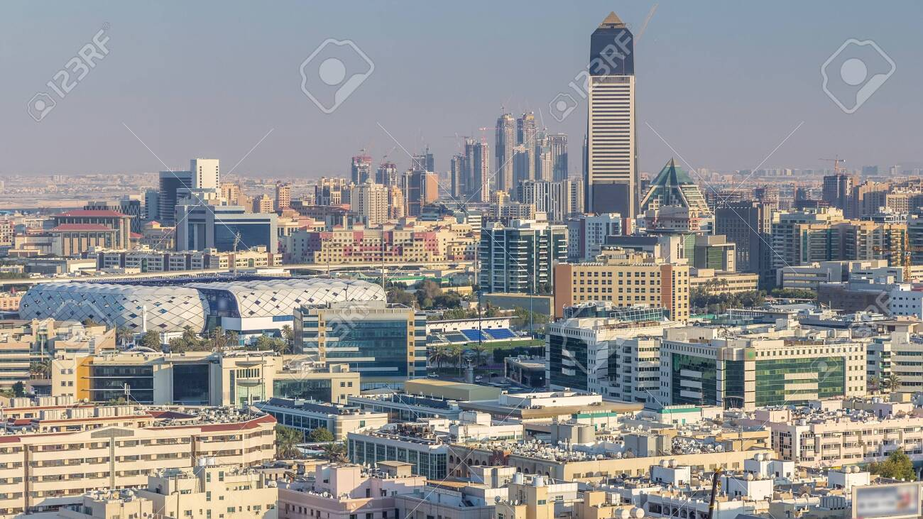 Aerial view of neighbourhood Deira and Dubai creek with typical old and modern buildings timelapse. Stadium and skyscrapses. View from skyscraper rooftop. Dubai, United Arab Emirates - 126891831