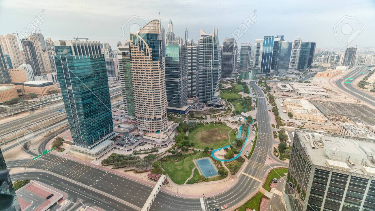 Jumeirah Lake Towers residential district aerial timelapse near Dubai Marina. Modern skyscrapers and park from above - 131188484
