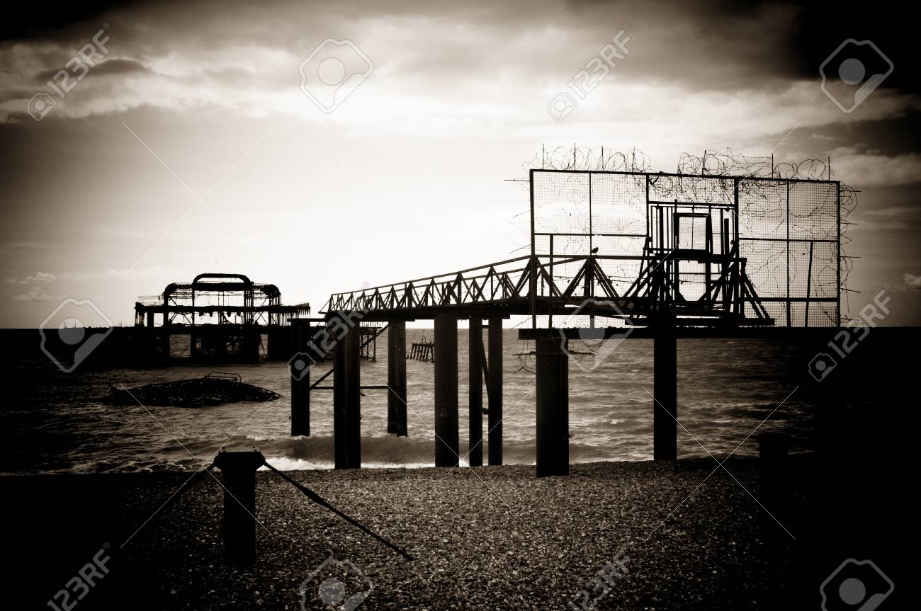 Remains of the old west pier on cold and wet day on beach in Brighton, England, UK Stock Photo - 18465595