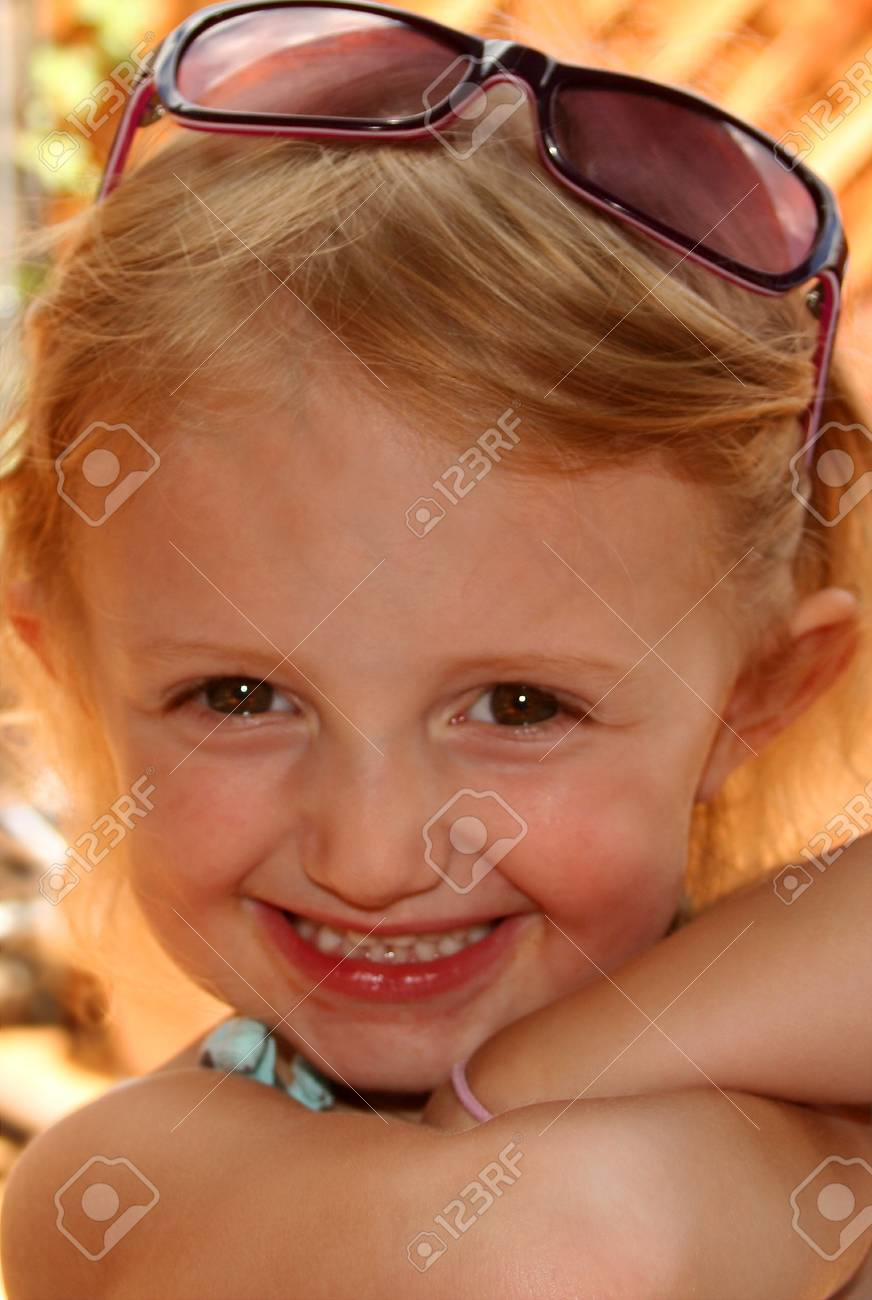 This three-year-old cutie just loves showing off her new sunglasses. Stock Photo - 1606709