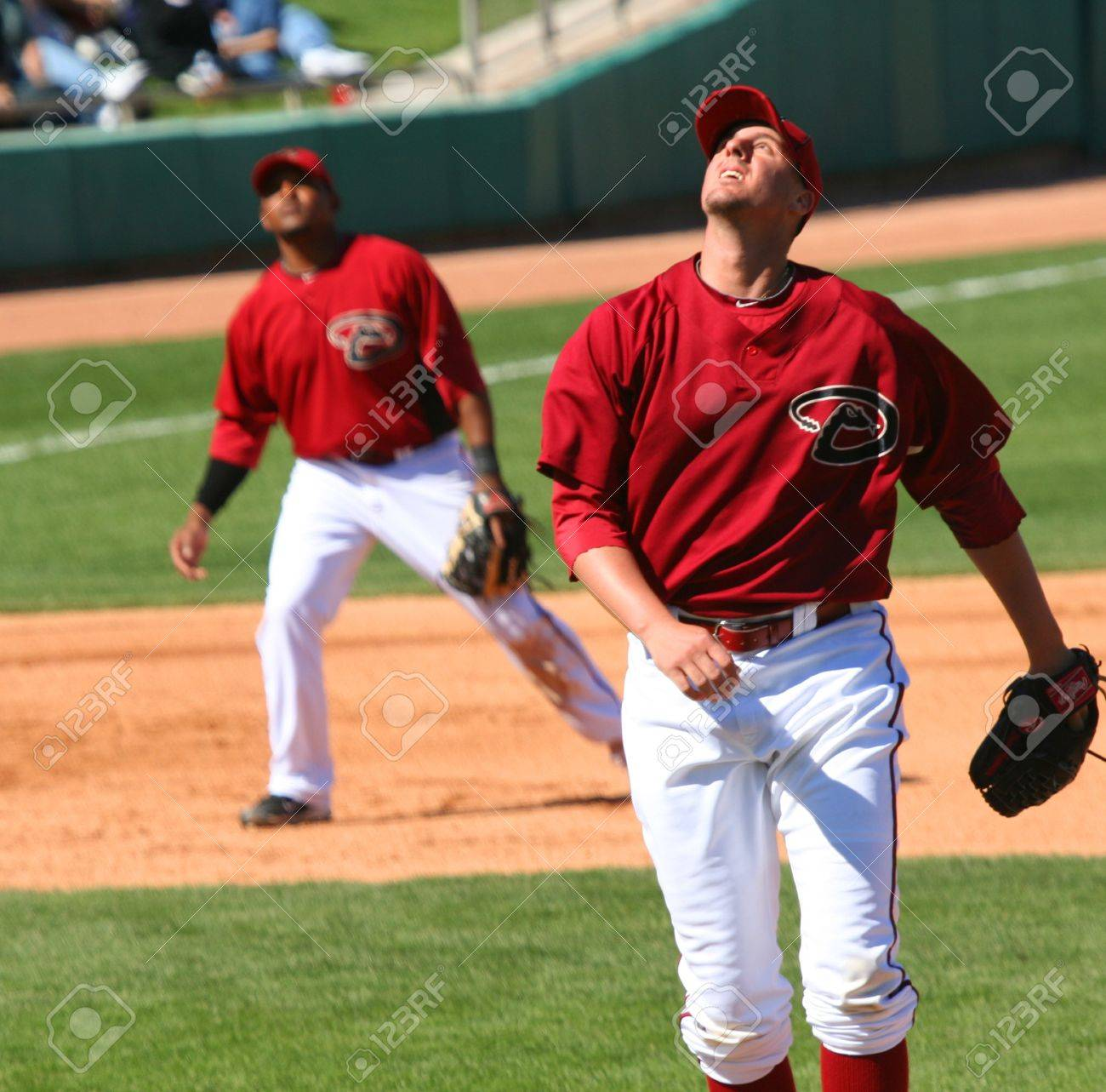 Bryan Augenstein follows a pop up in an Arizona Diamondbacks game against the Los Angeles Angels on March 11, 2010, at Tucson Electric Park in Tucson, Arizona, during spring training. Tony Abreu is playing third base. Stock Photo - 6890724